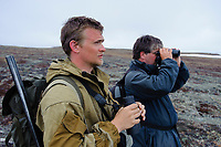 "Russian field biologist Egor Loktionov and German volunteer biologist Jochen Dierschke searching the tundra for Spoon-billed Sandpipers arriving on their breeding grounds in spring. Dierschke is one of many biologists and bird watchers that have been drawn to search for the Spoon-billed Sandpiper (and made the difficult ""pilgrimage"") over the years. Chukotka, Russia. May."