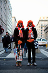 Mother and daughter Krista Jakes, left, and Kesha Covil, right, of Georgia, try to catch  a glimpse of President Barack Obama in the parade during the Second Inauguration of President Barack Obama on Jan. 21, 2013.