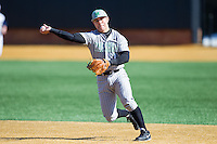 Andrew Dundon (14) of the Marshall Thundering Herd takes ground balls during infield practice prior to the game against the Georgetown Hoyas at Wake Forest Baseball Park on February 15, 2014 in Winston-Salem, North Carolina.  The Thundering Herd defeated the Hoyas 5-1.  (Brian Westerholt/Four Seam Images)