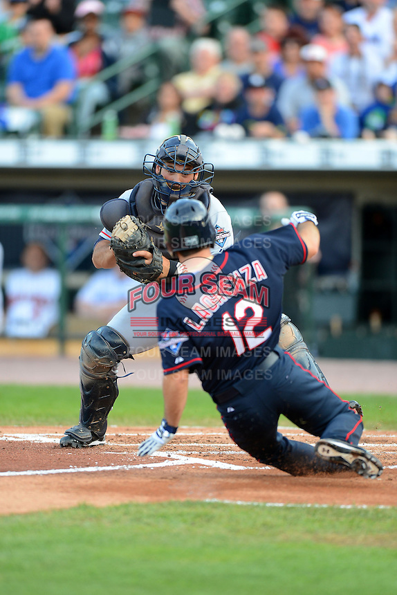 Catcher David Convertini tags out Vinny Laorenza #12 on a play at the plate during the MLB Pepsi Max Field of Dreams game on May 18, 2013 at Frontier Field in Rochester, New York.  (Mike Janes/Four Seam Images)