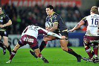 Josh Matavesi of the Ospreys takes on the Bordeaux Begles defence. European Rugby Champions Cup match, between the Ospreys and Bordeaux Begles on December 12, 2015 at the Liberty Stadium in Swansea, Wales. Photo by: Patrick Khachfe / JMP