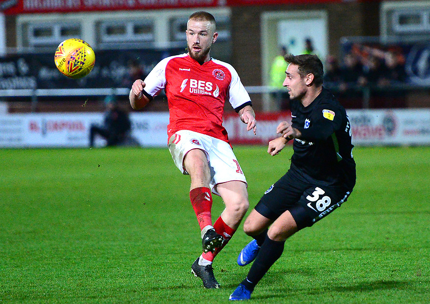 Fleetwood Town's Paddy Madden competes with Portsmouth's Brandon Haunstrup<br /> <br /> Photographer Richard Martin-Roberts/CameraSport<br /> <br /> The EFL Sky Bet League One - Fleetwood Town v Portsmouth - Saturday 29th December 2018 - Highbury Stadium - Fleetwood<br /> <br /> World Copyright © 2018 CameraSport. All rights reserved. 43 Linden Ave. Countesthorpe. Leicester. England. LE8 5PG - Tel: +44 (0) 116 277 4147 - admin@camerasport.com - www.camerasport.com