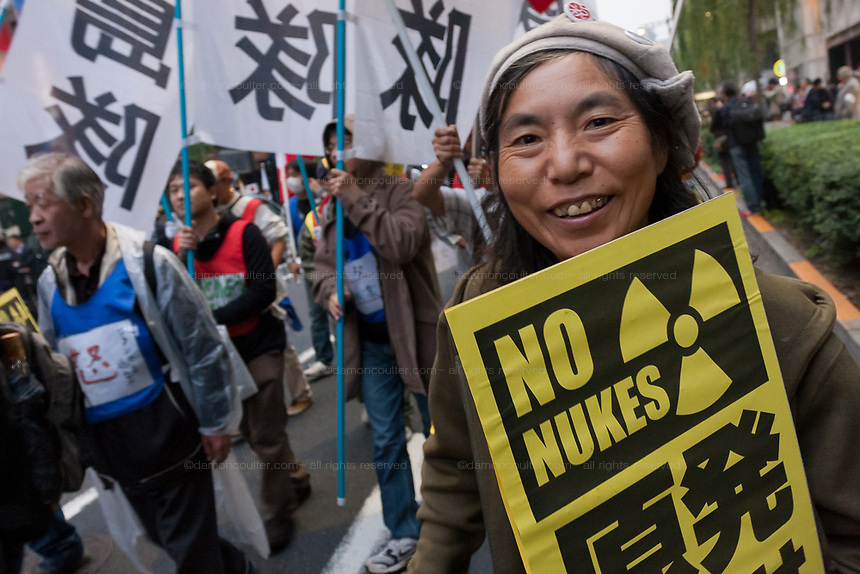 Sachiko Sato of the Fukushima Mothers group, holds an anti-nuclear sign at a demo by left wing groups in Hibiya, Tokyo, Japan Sunday November 6th 2011