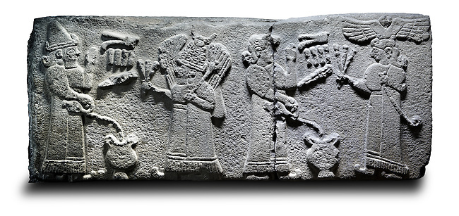 Picture & image of a Neo-Hittite orthostat with a releif sculpture a libation for the gods from Aslantepe ,  Malatya, Turkey. Ancora Archaeological Museum. The figure on the far left is beleived to be a king. He is facing a Bearded God wearing a bore tusk helmet. The God is holding a 3 pronged object and has a club resting on his shoulder. The 2 shaven characters on the right are mirror images of the two figures on the right except this time the king is on the far right waering a winged sun disc headress and holding a Lituus. The epigraphs identify the king and the cresent on the beared gods helmet identify him as Pugnus Mili The Sum and Moon God.