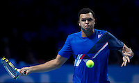 Jo-Wilfred Tsonga (FRA) against Roger Federer (SUI) in the Finals of the Barclays ATP World Tour Finals. Roger Federer beat Jo-Wilfred Tsonga 6-3 6-7 6-3..@AMN IMAGES, Frey, Advantage Media Network, Level 1, Barry House, 20-22 Worple Road, London, SW19 4DH.Tel - +44 208 947 0100.email - mfrey@advantagemedianet.com.www.amnimages.photoshelter.com.