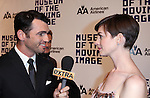 Tony Dovolani & Anne Hathaway attending The Museum of Moving Image salutes Hugh Jackman at Cipriani Wall Street in New York on December 11, 2012