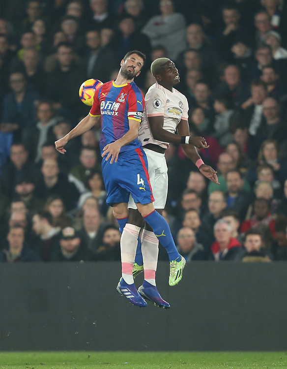 Manchester United's Paul Pogba and Crystal Palace's Luka Milivojevic<br /> <br /> Photographer Rob Newell/CameraSport<br /> <br /> The Premier League - Wednesday 27th February 2019  - Crystal Palace v Manchester United - Selhurst Park - London<br /> <br /> World Copyright © 2019 CameraSport. All rights reserved. 43 Linden Ave. Countesthorpe. Leicester. England. LE8 5PG - Tel: +44 (0) 116 277 4147 - admin@camerasport.com - www.camerasport.com