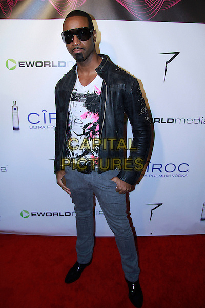 SEVEN MARCUS AURELIUS.The 2010 eWorld Music Awards at the famous Conga Room in downtown L.A., Los Angeles, California, USA..January 27th, 2009.full length black leather jacket jeans denim top pink print sunglasses shades .CAP/ADM/RAT.©Ratianda/AdMedia/Capital Pictures.