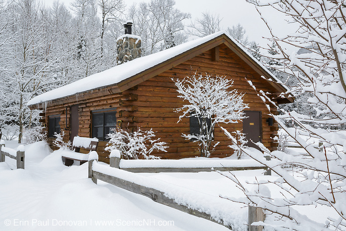 The Log cabin restroom at Lincoln Woods Trailhead in Lincoln, New Hampshire USA covered in snow during the winter months.