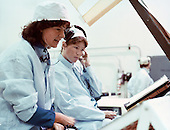 Astronaut Sally K. Ride (left) participates in a mission sequence test in preparation for STS-7, in the Kennedy Space Center's (KSC) vertical processing facility (VPF) on May 5, 1983. Dr. Ride is a mission specialist for the flight. She is joined here by Anna L. Fisher, a physician and astronaut from the 1978 group of 35, which also included Dr. Ride.  Dr. Ride passed away due to Pancreatic Cancer on Monday, July 23, 2012..Credit: NASA via CNP