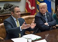 Governor Matt Bevin (Republican of Kentucky), left, makes remarks as United States President Donald J. Trump, right, listens during a prison reform roundtable in the Roosevelt Room of the White House in Washington, DC on Thursday, January 11, 2018.  <br /> CAP/MPI/RS<br /> &copy;RS/MPI/Capital Pictures