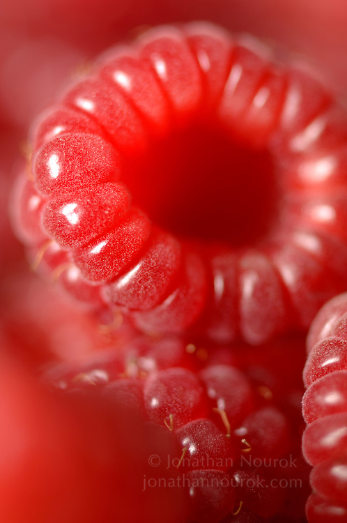 close-up of raspberries  - commercial/editorial licensing for this image is available through: http://www.gettyimages.com/detail/200280235-001/Stone