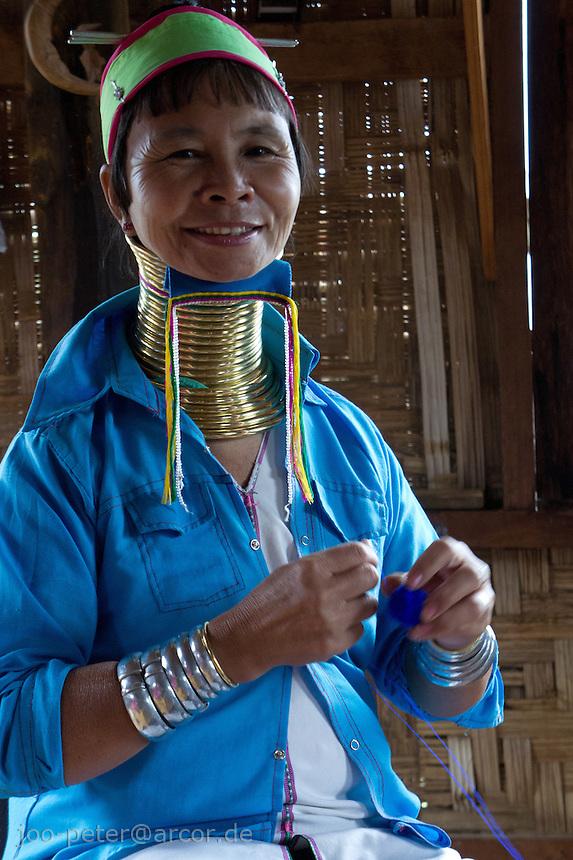 long-neck woman spinning fabric for weaving, ,village  Ywama at Inle Lake, Shan state,  Myanmar, 2011