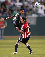 Santos Laguna defender Rafael Figueroa (19)  heads a ball past Chivas USA midfielder Sacha Kljestan (16). Chivas USA defeated the Santos of Laguna 1-0 during the 1st round of the 2008 SuperLiga at Home Depot Center stadium, in Carson, California on Wednesday, July 16, 2008.