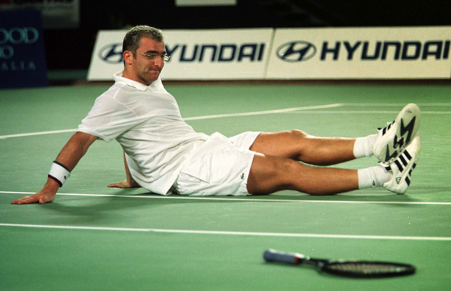 Guillaume Raoux of France sits on the court after he stumbled during his match against Wayne Ferriera of South Africa at the Hopman Cup mixed teams championship in Perth, Australia Tuesday Jan 5, 1999. Raoux recovered to win the match, defeating Ferriera 6-3, 7-5. (AP Photo/Jean-Marie Blase)