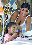 Blanca Aguilar helps her 4-year old daughter Evelyn Garcia Aguilar as she paints during a session of the early intervention program of Piña Palmera, a center for community based rehabilitation for people living with disabilities in Zipolite, a town in Oaxaca, Mexico. The girl is deaf.