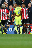 Tempers flare between Ryan Woods of Brentford  and  Joe Ledley of Derby County during the Sky Bet Championship match between Brentford and Derby County at Griffin Park, London, England on 26 September 2017. Photo by Carlton Myrie / PRiME Media Images.