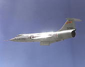 "1965 photo of an F-104 in flight.  Known as ""the missile with a man in it,"" the stubby-winged Lockheed F-104 Starfighter was the first U.S. jet fighter in service to fly Mach 2, twice the speed of sound. Designed as a high-performance day fighter, the F-104 had excellent acceleration and top speed. It first flew on February 7, 1954.   While built for the United States Air Force, most Starfighters were flown by other countries, particularly Canada, Italy, Germany, and Japan. Many were built under license overseas.  The National Aeronautics and Space Administration (NASA) flew this F-104A for 19 years as a flying test bed and a chase plane. It was used to test the reaction controls later used on the North American X-15. .Credit: U.S. Air Force via CNP"