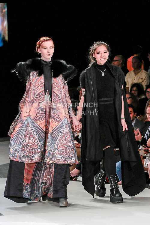 Graduating fashion student Debra Lin, walks runway with model at the close of the 2013 Pratt Institute Fashion Show, on April 25, 2013.
