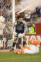 Pat Onstad retrieves ball from net as the Revolution score and the Revolution militia celebrate. The New England Revolution tied the Houston Dynamo, 1-1, on May 27 at Gillette Stadium.