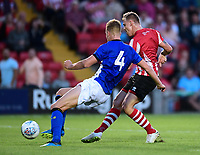 Lincoln City's Harry Anderson gets a shot in under pressure from Sheffield Wednesday's Joost Van Aken<br /> <br /> Photographer Chris Vaughan/CameraSport<br /> <br /> Football Pre-Season Friendly - Lincoln City v Sheffield Wednesday - Friday 13th July 2018 - Sincil Bank - Lincoln<br /> <br /> World Copyright &copy; 2018 CameraSport. All rights reserved. 43 Linden Ave. Countesthorpe. Leicester. England. LE8 5PG - Tel: +44 (0) 116 277 4147 - admin@camerasport.com - www.camerasport.com