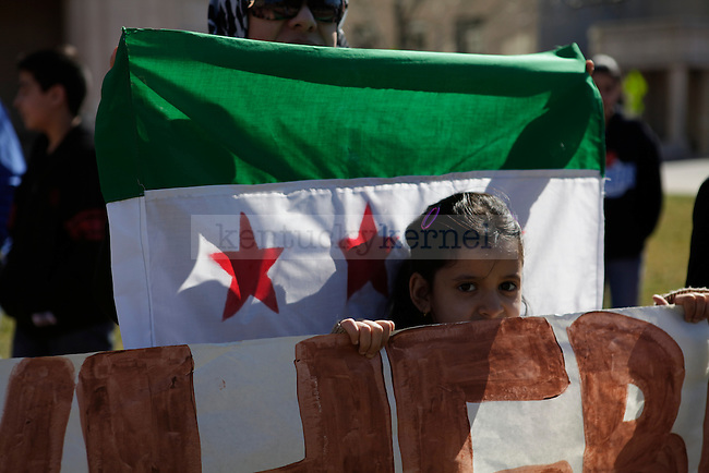 Essra Bakoush, age 7, helping hold up a banner at the rally for Syria, in front of the courthouse in Lexington, Ky., on Sunday, Feb. 26, 2012. Photo by Latara Appleby | Staff ..