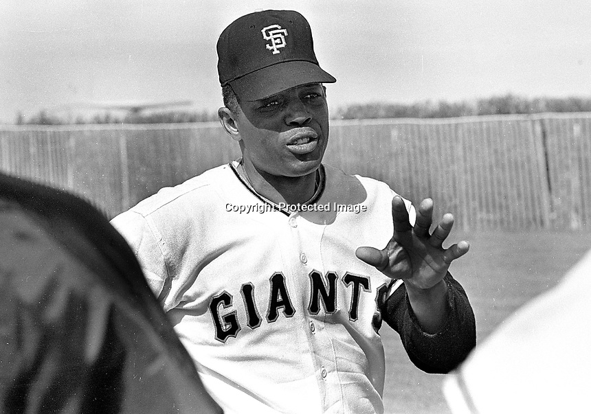 Giants Willie Mays talking to teamates at Spring Training in Arizona...(1968 photo/Ron Riesterer)