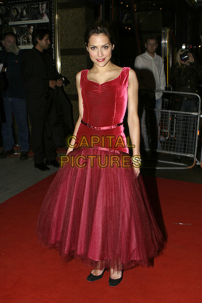 """BRITTANY MURPHY.Red Carpet Arrivals at """"Sin City"""" Uk Film Premiere,.Empire Cinema Leicester Square, .London, May 23rd 2005..full length red pink velvet cerise dress full skirt ribbons.Ref: AH.www.capitalpictures.com.sales@capitalpictures.com.©Adam Houghton/Capital Pictures."""
