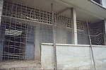 OUTSIDE OF SCHOOL WITH WIRE FENCE THAT WAS TURNED INTO A PRISON BY KMER ROUGE IN CAMBODIA