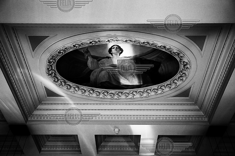 The ceiling, decorated with a personification of political economy (Oeconomia Politica), in offices of the Swiss National Bank on Bundesplatz. /Felix Features