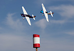 Philip Goforth in Notty Girl leads Vito Wypraechtiger in Scarlet Screamer in a Formula One heat race during the National Championship Air Races in Reno, Nevada on Thursday, September 14, 2017.