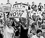 Pro-healthcare reform constituents cheer during Rep. Frank Pallone's town hall meeting at Red Bank Middle School in Red Bank, N.j., on Aug. 25, 2009.