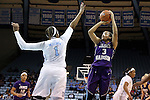 02 January 2014: JMU's Toia Giggetts (3) shoots over North Carolina's Stephanie Mavunga (1). The University of North Carolina Tar Heels played the James Madison University Dukes in an NCAA Division I women's basketball game at Carmichael Arena in Chapel Hill, North Carolina.