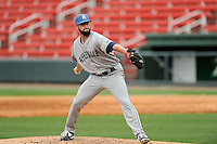 Pitcher Scott Firth (23) of the Asheville Tourists delivers a pitch in a game against the Greenville Drive on Friday, April 24, 2015, at Fluor Field at the West End in Greenville, South Carolina. Greenville won, 5-2. (Tom Priddy/Four Seam Images)