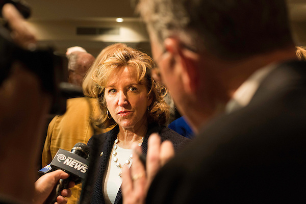"""April 16, 2014. Durham, North Carolina.<br />  Senator Kay Hagan, center, spoke with the press after an event to award a posthumous Bronze Star. Hagan has been largely absent from the campaign trail even as several Republican challengers have mounted campaigns to defeat her in this year's election.<br />  Kay Hagan (D),  US Senator from North Carolina, attended an event to honor the military service of Donald """"Buddy"""" Moore, Hagan awarded Moore's widow Wanda a posthumous Bronze Star, as well as several other medals, for his service in World War II."""