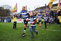Dan Bowden of Bath Rugby, mascot in hand, runs out onto the field. Aviva Premiership match, between Bath Rugby and Saracens on December 3, 2016 at the Recreation Ground in Bath, England. Photo by: Patrick Khachfe / Onside Images