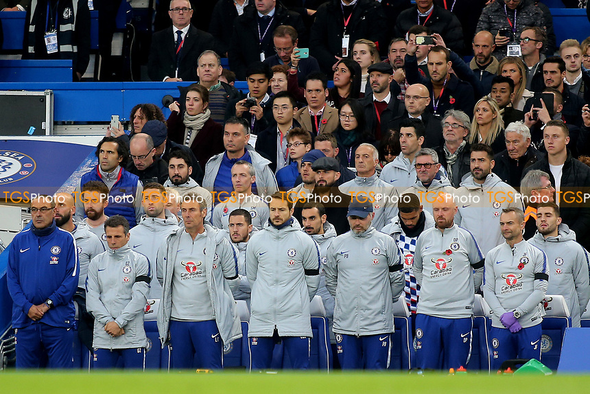 Chelsea FC Manager, Maurizio Sarri and the Chelsea substitutes and coaching staff observe a one minute silence in memory of the five people that lost their lives in last weekend's tragic helicopter crash outside The King Power Stadium at Leicester City, including Chairman Vichai Srivaddhanaprabha during Chelsea vs Crystal Palace, Premier League Football at Stamford Bridge on 4th November 2018