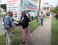 "NWA Democrat-Gazette/J.T. WAMPLER Lioneld Jordan, Fayetteville mayor, (left) visits with Sister Simone Campbell Sunday Sept. 13, 2015. Campbell is with NETWORK, a National Catholic Social Justice Lobby, which stopped in Fayetteville at St. Paul's Episcopal Church on its fourth national ""Nuns on the Bus"" tour themed, ""Bridge the Divides: Transform Politics,"". The 13-day, seven-state tour kicked off in St. Louis on Sept. 10 and ends in Washington, D.C. on Sept. 22, where NETWORK will host a rally to welcome Pope Francis."