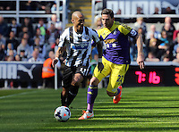 Pictured L-R: Yoan Gouffran of Newcastle chased by Angel Rangel of Swansea. Saturday 19 April 2014<br /> Re: Barclay's Premier League, Newcastle United v Swansea City FC at St James Park, Newcastle, UK.