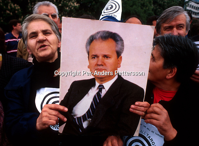 Serbian demonstrators holding a portrait of Slobodan Milosevic, the former Serbian strongman on May 5, 1999 in central Skopje in Macedonia. The people demonstrated against the NATO precence in Macedonia and Kosovo. Hundreds of thousands of ethnic Albanian Kosovars fled into Macedonia and Albania during the Serb terror of Kosovo..(Photo: Per-Anders Pettersson/ Getty Images)