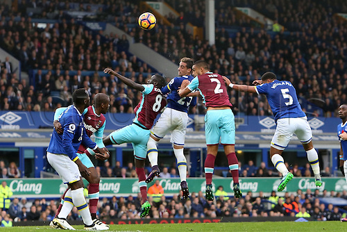 30.10.2016. Goodison Park, Liverpool, England. Premier League Football. Everton versus West Ham United. Ramiro Funes Mori of Everton wins a header from Winston Reid of West Ham United and Cheikhou Kouyate of West Ham United