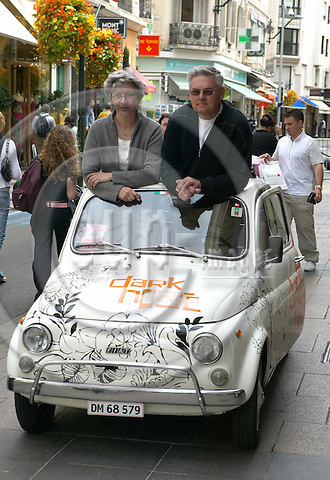 """CANNES - FRANCE 16. MAY 2005 -- Film Festival 2005 Dark Horse (Original Title: VOKSNE MENNESKER). Vibeke and Niels Faarup Christensen with the Fiat 500, which plays an important role in the movie. -- PHOTO: CHRISTIAN T. JOERGENSEN / EUP-IMAGES ....This image is delivered according to terms set out in """"Terms for Delivery of Photography & Text"""". (Please see www.fotofactory.dk for more details).."""