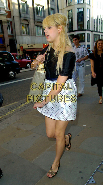 PEACHES GELDOF.Spotted walking along the Strand past the Adelphi Theatre towards Waterloo Bridge, London, England..July 17th, 2007.full length white black top dress polka dot beige bag purse quilted sandals tattoo mouth open .CAP/CAN.©Can Nguyen/Capital Pictures