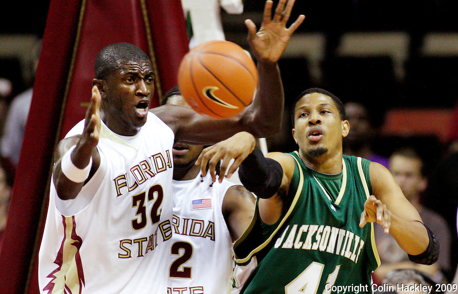 TALLAHASSEE, FL 11/16/09-FSU-JU BB09 CH01-Florida State's Solomon Alabi, left, puts pressure on Jacksonville's  Lehmon Colbert during first half action Monday at the Donald L. Tucker Center in Tallahassee...COLIN HACKLEY PHOTO