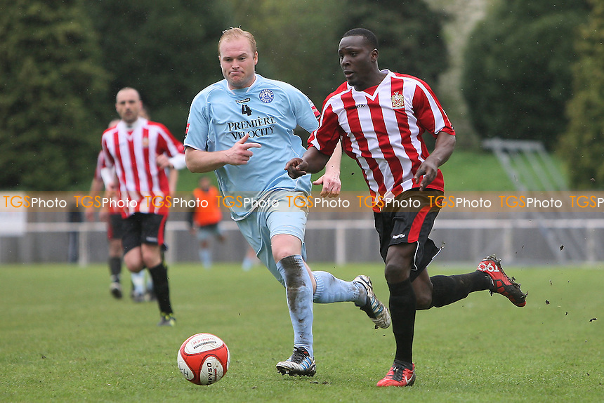 Fola Orilonishe of Hornchurch evades Dave Collis of Billericay - AFC Hornchurch vs Billericay Town - Ryman League Premier Division Football at The Stadium, Upminster Bridge, Essex - 09/04/12 - MANDATORY CREDIT: Gavin Ellis/TGSPHOTO - Self billing applies where appropriate - 0845 094 6026 - contact@tgsphoto.co.uk - NO UNPAID USE.