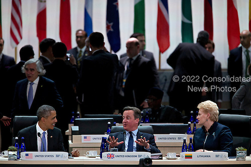 David Cameron, U.K. prime minister, center, talks to United States President Barack Obama, left, and Dalia Grybauskaite, Lithuania's president, during a closing session at the Nuclear Security Summit in Washington, D.C., U.S., on Friday, April 1, 2016. After a spate of terrorist attacks from Europe to Africa, Obama is rallying international support during the summit for an effort to keep Islamic State and similar groups from obtaining nuclear material and other weapons of mass destruction. <br /> Credit: Andrew Harrer / Pool via CNP
