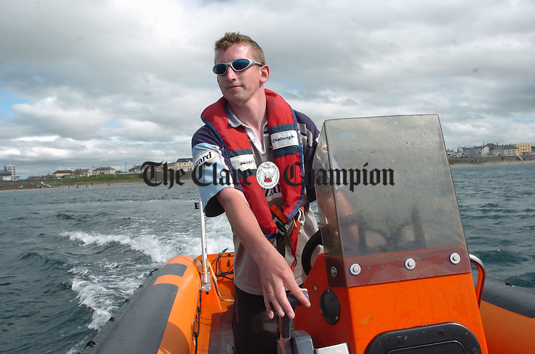 David O Carroll of Kilkee Diving Centre heads out into the bay to watch the Kilke bay Swim in Saturday last. Photograph by John Kelly.