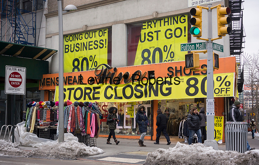 A store on Fulton Street in Downtown Brooklyn in New York announces that it is soon going out of business, offering discounts on merchandise, on Saturday, February 7, 2015. (© Richard B. Levine)