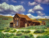 F00136M.tiff   Abandoned house in ghost town of Bodie, California with cumulus clouds.