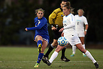 14 November 2014: South Dakota State's Shelby Raper (4) and North Carolina's Joanna Boyles (10). The University of North Carolina Tar Heels hosted the South Dakota State University Jackrabbits at Fetzer Field in Chapel Hill, NC in a 2014 NCAA Division I Women's Soccer Tournament First Round match. UNC won the game 2-0.